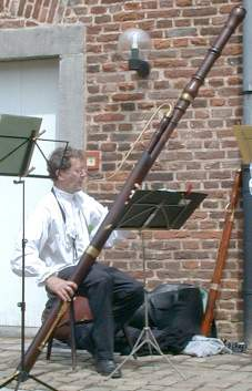 Click for a larger picture.  Hans von Busch playing a Verjat contra bassoon.